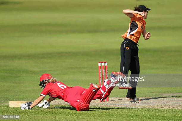 Emma Lamb of Lancashire leaps over the crease during the Kia Super League match between Lancashire Thunder and Southern Vipers at Stanley Park on...