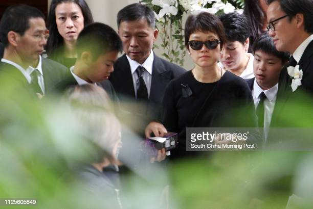 Emma Liu wife of gastroenterology and haepatology specialist Dr Wayne Hu Hsingcheng who died in a yacht accident attends the funeral at St John's...