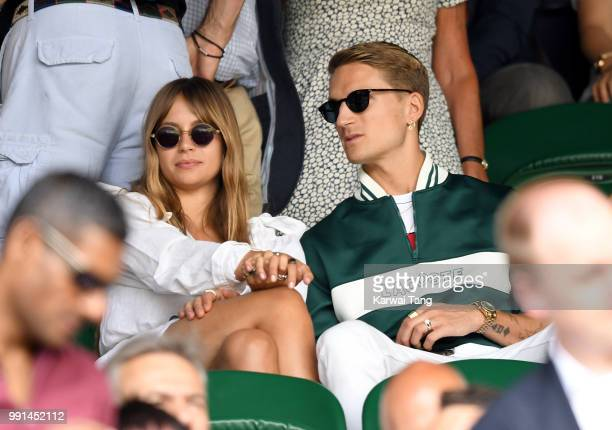 Emma Louise Connolly and Oliver Proudlock attend day three of the Wimbledon Tennis Championships at the All England Lawn Tennis and Croquet Club on...