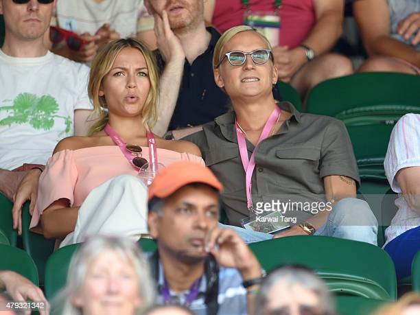 Emma Louise Connolly and Oliver Proudlock attend the Grigor Dimitrov v Richard Gasquet match on day five of the annual Wimbledon Tennis Championships...