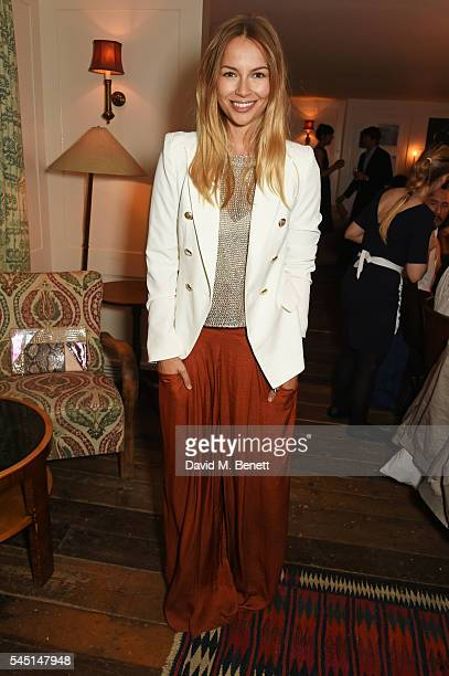 Emma Louise Connolly attends a private dinner hosted by Dylan Jones and JeanDavid Malat to celebrate artist Mike Dargas at Soho House on July 5 2016...