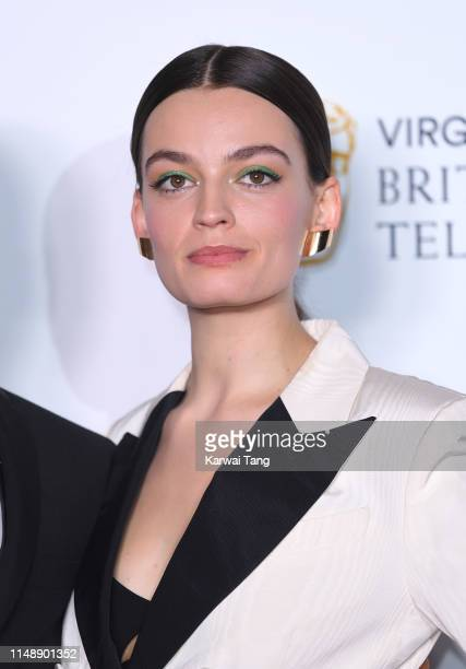 Emma Mackey poses in the Press Room at the Virgin TV BAFTA Television Award at The Royal Festival Hall on May 12 2019 in London England