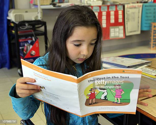Emma Madden first grader reads a book at Grasonville Elementary School which uses a reading curriculum know as Success for All that the federal...