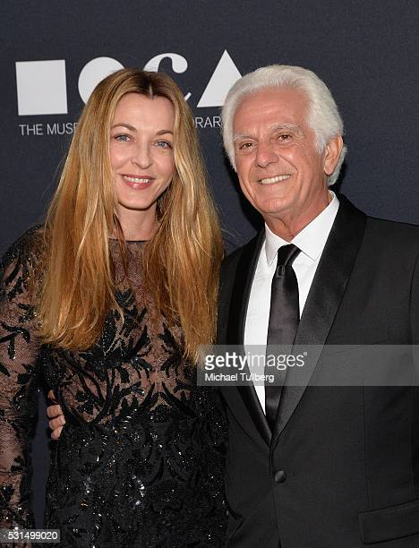 Emma Marciano and MOCA Gala Cochair Maurice Marciano attend the MOCA Gala 2016 at The Geffen Contemporary at MOCA on May 14 2016 in Los Angeles...