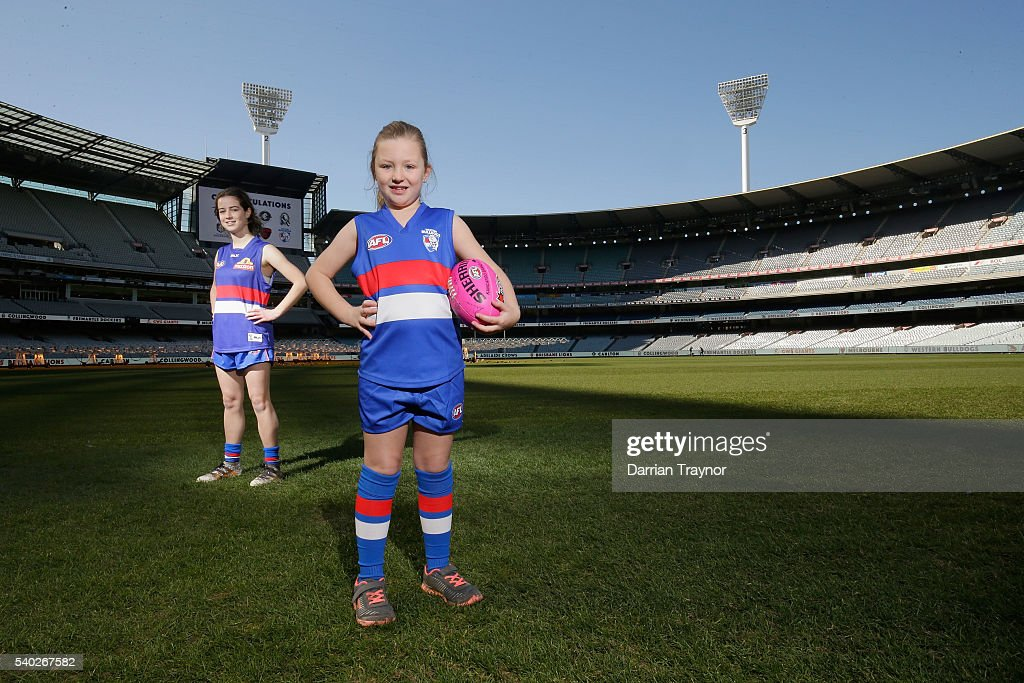 Emma Martin and Lilliana White pose for a photo wearing the Western Bulldogs jumpers during an AFL media opportunity to announce the competing teams in next year's inaugural Women's National League at Melbourne Cricket Ground on June 15, 2016 in Melbourne, Australia.