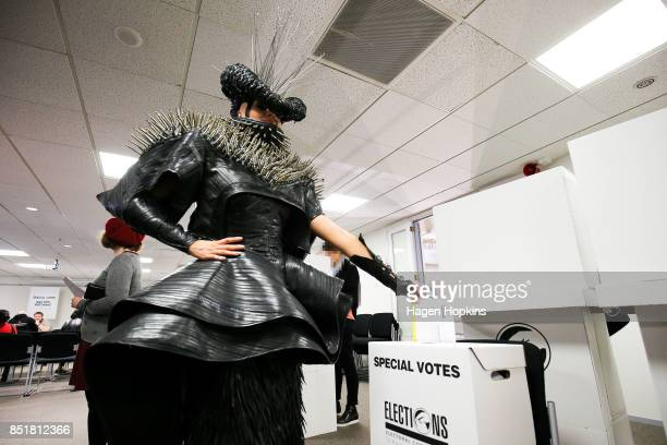 Emma Martin dressed in World of WearableArt garment 'Refuse Refuge' by Grace DuVal of the United States votes at Wellington City Library on September...