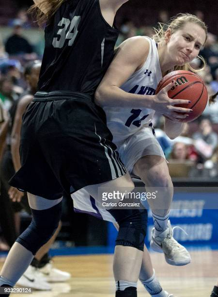 Emma McCarthy of Amherst College drove to the basket during the Division III Women's Basketball Championship held at the Mayo Civic Center on March...