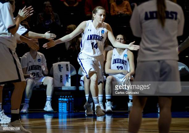 Emma McCarthy of Amherst College ran out during team introductions at the Division III Women's Basketball Championship held at the Mayo Civic Center...