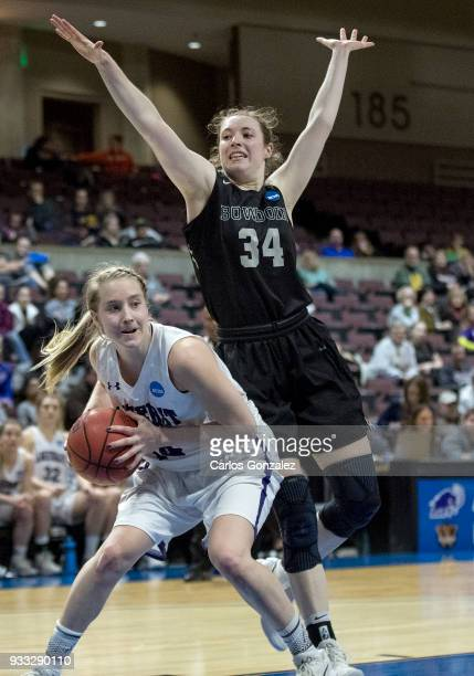 Emma McCarthy of Amherst was defended by Cordelia Stewart of Bowdoin during the Division III Women's Basketball Championship held at the Mayo Civic...