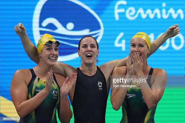 Emma McKeon Brittany Elmslie and Bronte Campbell of Australia celebrate winning gold and a new world record in the Final of the Women's 4 x 100m...