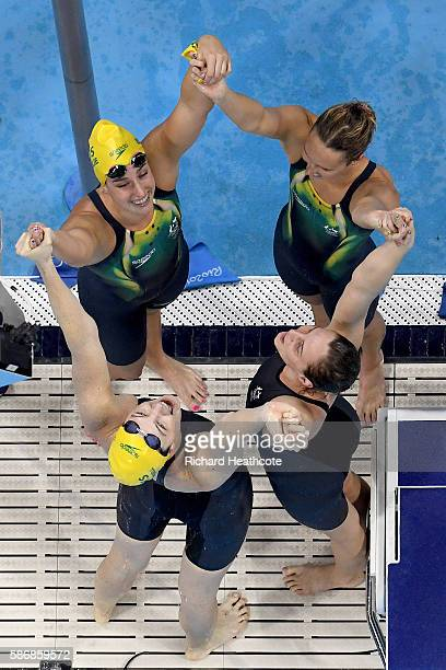 Emma McKeon, Brittany Elmslie, Bronte Campbell and Cate Campbell of Australia celebrate winning gold and a new world record in the Final of the...