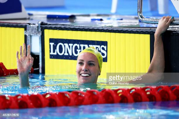 Emma McKeon of Australia celebrates winning the gold medal in the Women's 200m Freestyle Final at Tollcross International Swimming Centre during day...