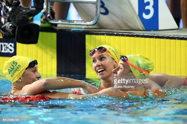 Emma McKeon of Australia celebrates with teammates Madeline Groves and Brianna Throssell following the Women's 100m Butterfly Final on day two of the...