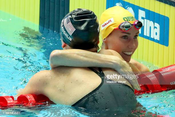 Emma McKeon of Australia is congratulated by Katie McLaughlin of the United States after winning the Women's 4x200m Freestyle Final on day five of...