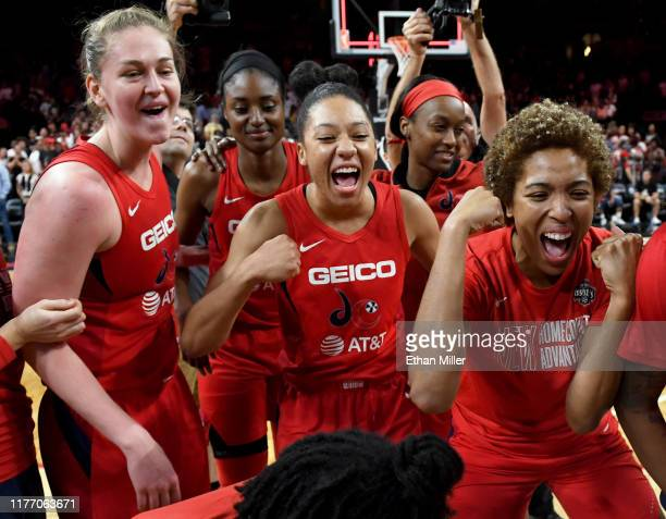 Emma Meesseman Aerial Powers and Tianna Hawkins of the Washington Mystics celebrate on the court after their 9490 victory over the Las Vegas Aces in...