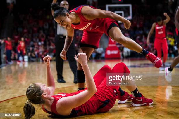 Emma Meesseman and Natasha Cloud of the Washington Mystics celebrate against the Las Vegas Aces during the second half of Game One of the 2019 WNBA...