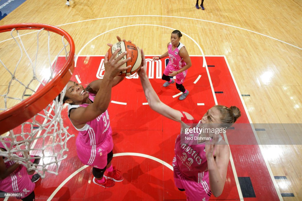 Emma Meesseman #33 of the Washington Mystics and Krystal Thomas #34 of the Washington Mystics go for the rebound during the game against the Los Angeles Sparks on August 16, 2017 at the Verizon Center in Washington, DC.