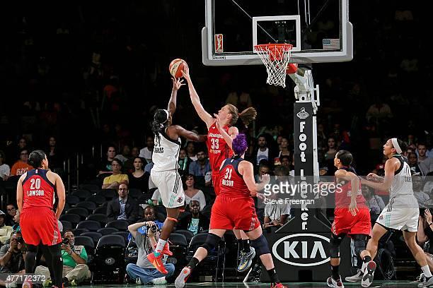 Emma Meesseman of the Washington Mystics blocks the shot of Tina Charles of the New York Liberty on June 14 2015 at Madison Square Garden in New York...