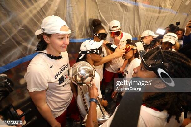 Emma Meesseman of the Washington Mystics celebrates in the locker room after winning the 2019 WNBA Finals against the Connecticut Sun during Game...