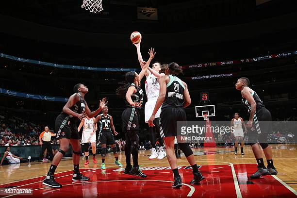 Emma Meesseman of the Washington Mystics shoots against Tina Charles of the New York Liberty at the Verizon Center on August 16 2014 in Washington DC...
