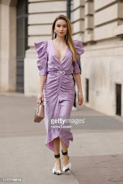 Emma Miller wearing lavender midi dress outside the Elie Saab show during Womenswear Spring/Summer 2020 show Paris Fashion Week on September 28 2019...