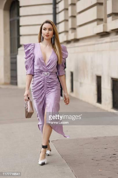 Emma Miller wearing lavender midi dress outside the Elie Saab show during Womenswear Spring/Summer 2020 show Paris Fashion Week on September 28 2019...