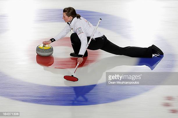 Emma Miskew of Canada throws a stone during the 3rd and 4th Play-Off match between USA and Canada on Day 8 of the Titlis Glacier Mountain World...