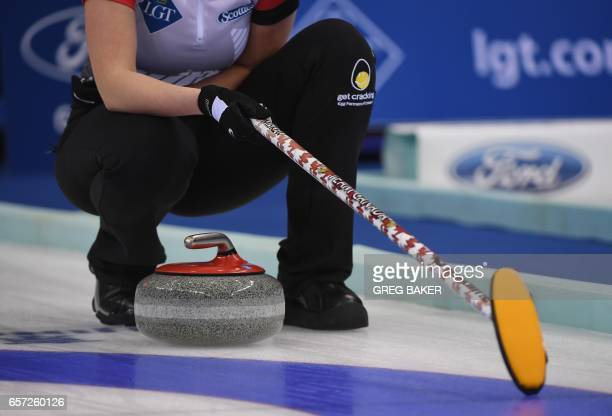 Emma Miskew of Canada waits above a stone during their match against Russia at the Women's Curling World Championships in Beijing on March 24 2017 /...