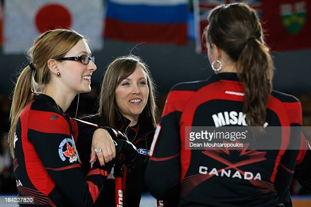 Emma Miskew, Rachel Homan and Alison Kreviazuk of Canada share a joke in the match between Canada and Japan during Day 6 of the Titlis Glacier...