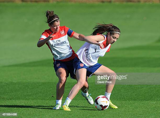 Emma Mitchell and Carla Humphrey of Arsenal Ladies during their training session at London Colney on July 3 2014 in St Albans England