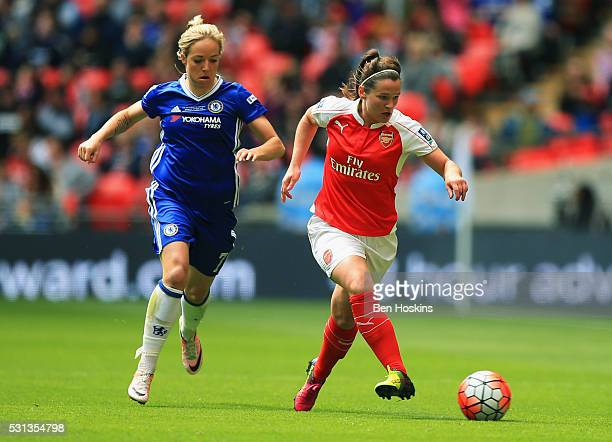 Emma Mitchell of Arsenal beats Gemma Davison of Chelsea to the ball during the SSE Women's FA Cup Final between Arsenal Ladies and Chelsea Ladies at...
