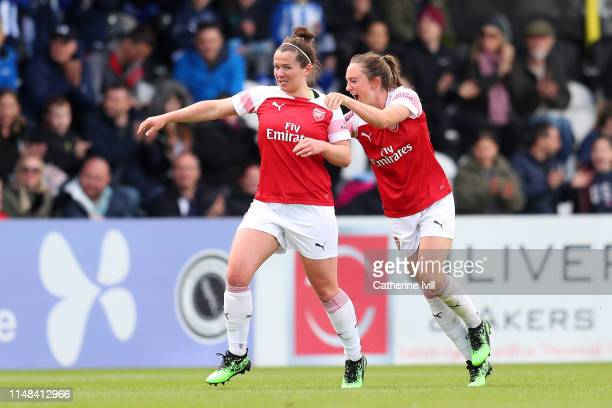 Emma Mitchell of Arsenal celebrates after scoring her team's first goal during the WSL match between Arsenal Women and Manchester City Women at...