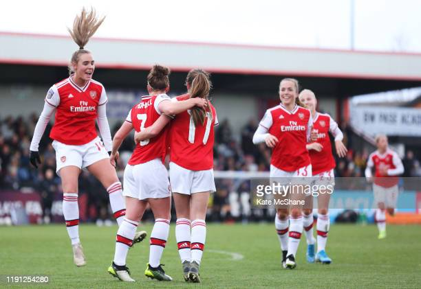 Emma Mitchell of Arsenal celebrates scoring her side's eleventh goal with team mates during the Barclays FA Women's Super League match between...