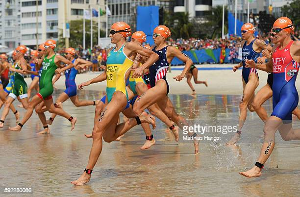 Emma Moffatt of Australia Sarah True of the United States and Flora Duffy of Bermuda compete during the Women's Triathlon on Day 15 of the Rio 2016...