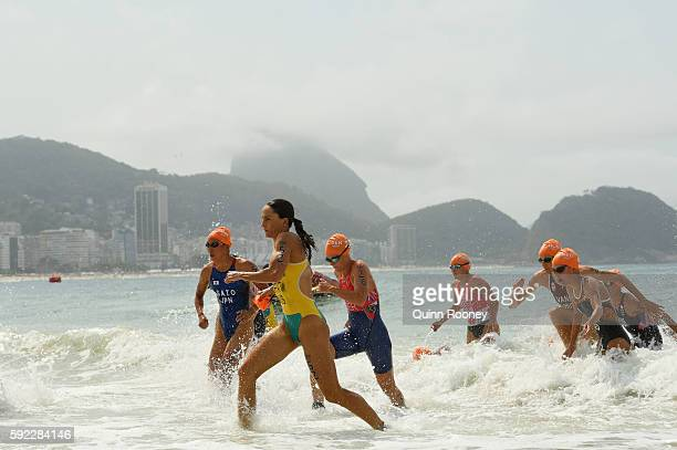 Emma Moffatt of Australia Yuka Sato of Japan and Flora Duffy of Bermuda leave the water during the Women's Triathlon on Day 15 of the Rio 2016...