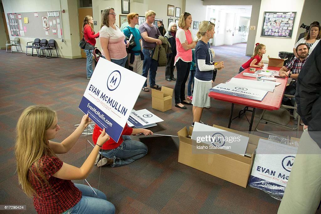 Emma Moulton, 13, of Caldwell, Idaho, helps distribute campaign signs for independent presidential candidate Evan McMullin during his visit to Boise High School on Saturday, Oct. 22, 2016, in Boise, Idaho. Emma's mother, Alison Moulton, said this is the first her family has become politically involved during an election, but they volunteered to help McMullin.