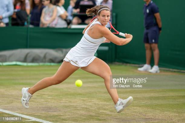Emma Navarro of The United States in action against Daria Snigur of the Ukraine in the Girls Singles Semi Finals on Court Five during the Wimbledon...
