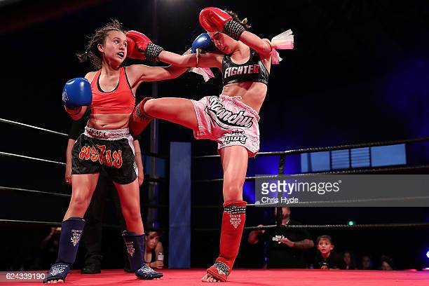 NOVEMBER 19 Emma Nesbit and Jasmine Parr exchange kicks during the Muay Thai fight in the Siam Junior show at Eagle sports complex on November 19...