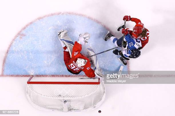 Emma Nuutinen of Finland collides with Nadezhda Morozova of Olympic Athlete from Russia in the first period during the Women's Ice Hockey Bronze...
