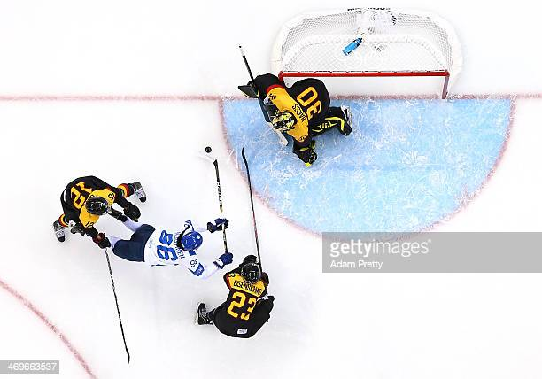 Emma Nuutinen of Finland dives for a shot against Susann Gotz Tanja Eisenschmid and Jennifer Harss of Germany in the first period during the Women's...