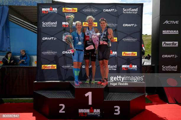 Emma Pallant of Britain celebrates winning the women's race at Ironman 703 Edinburgh with Lucy Gossage of Britain second and Sarah True of USA third...