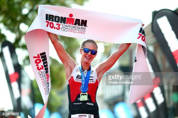 Emma Pallant of Great Britain celebrates as she wins the womens pro race during the IRONMAN 70.3 Staffordshire on June 10, 2018 in Lichfield, England.