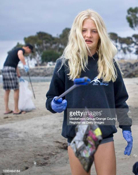 Emma Parker reacts to beach trash while cleaning up the Fourth of July mess at Doheny State Beach in Dana Point along with dozens of volunteers....