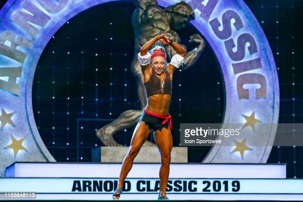 Emma Paveley competes in Fitness International as part of the Arnold Sports Festival on March 1 at the Greater Columbus Convention Center in Columbus...