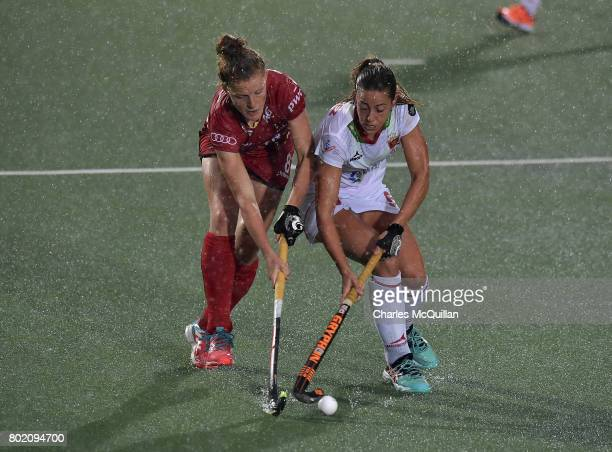Emma Puvrez of Belgium and Maria Lopez of Spain during the FINTRO Women's Hockey World League SemiFinal Pool B game between Belgium and Spain on June...