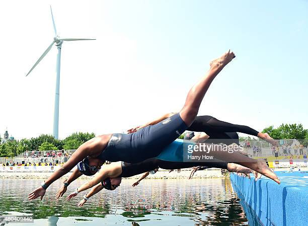 Emma Quintanilla Lizano of Honduras and Kristel Kobrich of Chile start in the women's open water swimming at Ontario Place during the 2015 Pan...