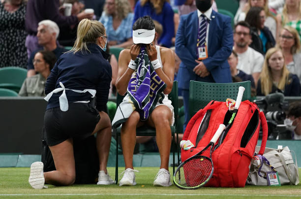 Emma Raducanu appears to be struggling during a break in the match against Ajla Tomljanovic in their Women's Singles Round of 16 match on day seven...