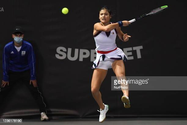 Emma Raducanu, in action - serving the ball in her match against Polons Hercog on day four of WTA 250 Transylvania Open Tour held in BT Arena,...