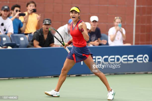 Emma Raducanu of Great Britain celebrates against Stefanie Voegele of Switzerland during her Women's Singles first round match on Day Two of the 2021...