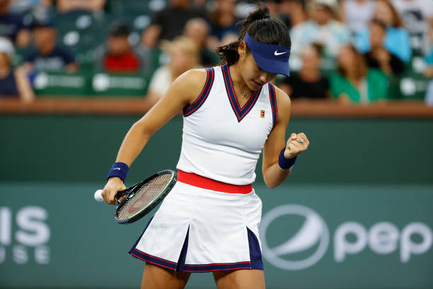 Emma Raducanu of Great Britain celebrates during a match against Aliaksandra Sasnovich of Belarus during the BNP Paribas Open at the Indian Wells...